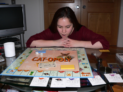 Jasmine getting excited by the Cat-opoly board game Peter gave her for Christmas