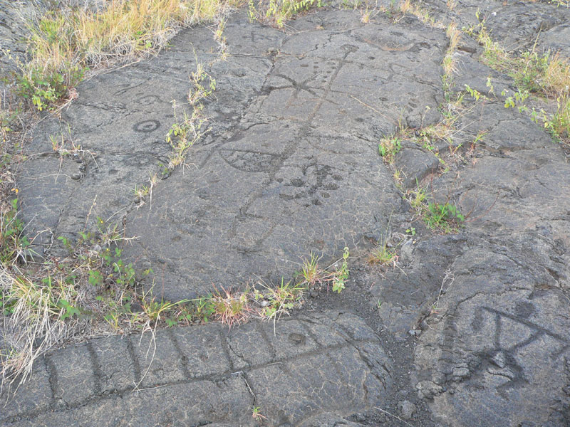 Petroglyphs carved into the lava