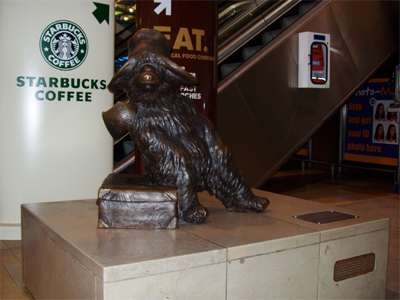 Statue of Paddington bear at Paddington Station in London